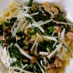 Sauteed winter greens and spicy Italian sausage with Farfalle pasta. Buon appetito!