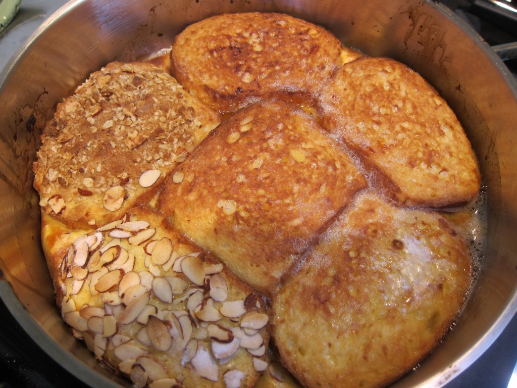 Note bubbling butter creating crusty edges and bottom surface. Lower left piece was flavored with almond syrup and topped with sliced almonds. Upper left piece has streusel topping.