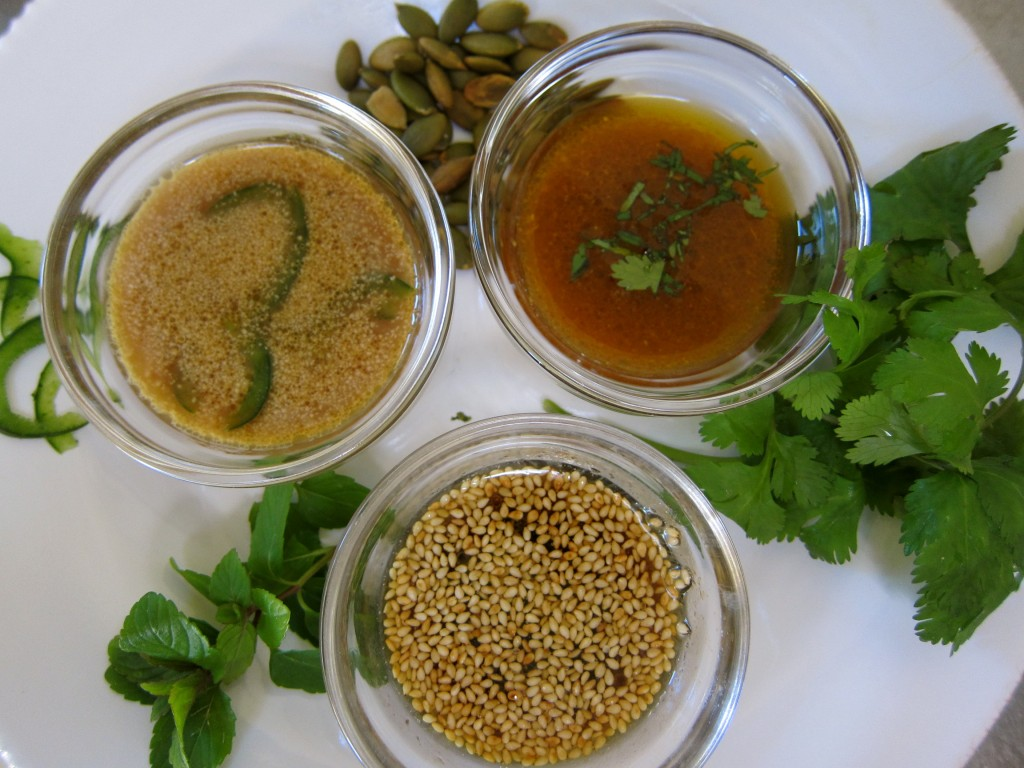 From bottom: Asian Vinaigrette with sesame seeds; Vietnamese Vinaigrette with sliced Poblano Chili and Mexican Vinaigrette with Cilantro